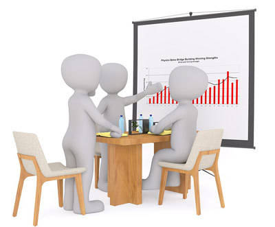 Human-like figures in a meeting discuss a chart.